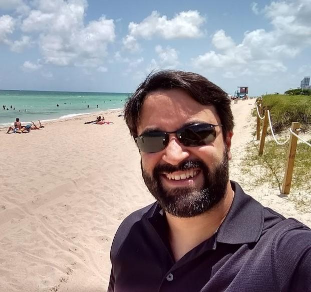 fabricio na praia da Flórida - Equipe PoaTek inicia 2018 com ponte aérea POA - Flórida!